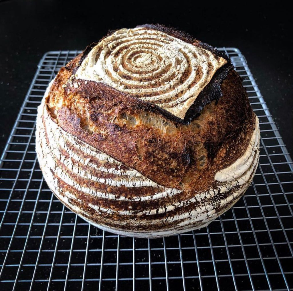 large bread loaf on cooling rack by bread ahead