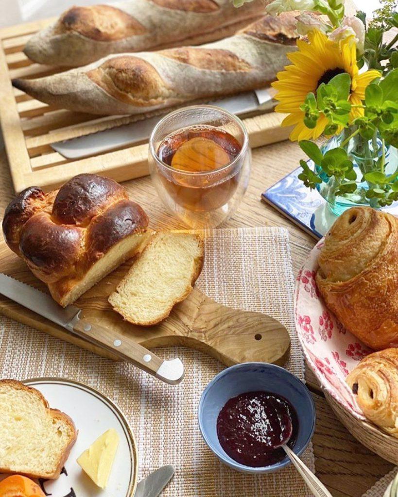 Breakfast spread with fresh baguette and brioche