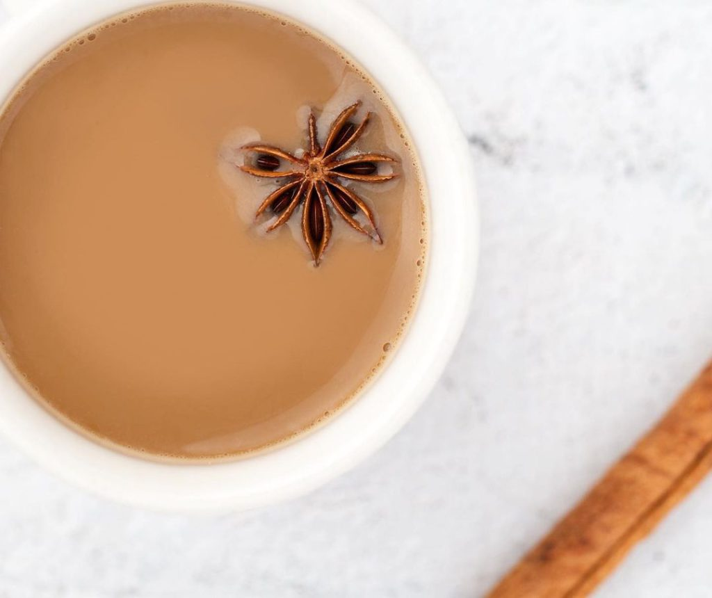 Cup of chai with star of anis and cinnamon from Chai Blue