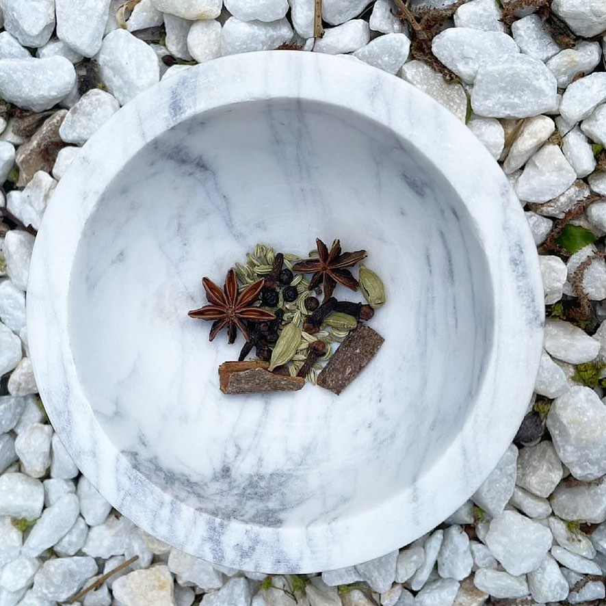Chai mix in marble grinding bowl from Chai Blue